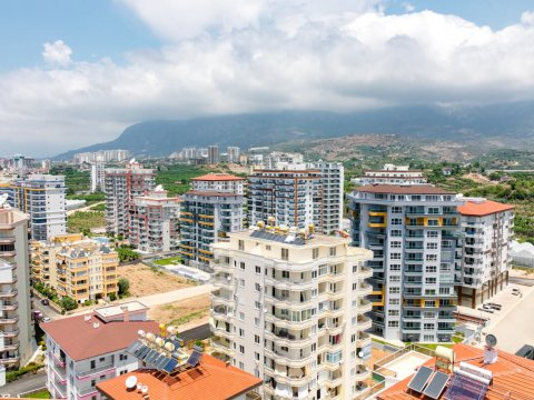 If I buy real estate in Turkey, do I need to get a residence permit right away? What documents will be required to make a request for a residence permit?